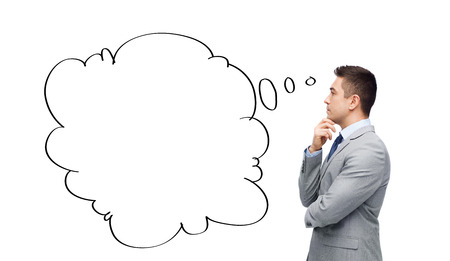 thought bubble: business, people, communication and information concept - thinking businessman in suit with text bubble doodle making decision Stock Photo