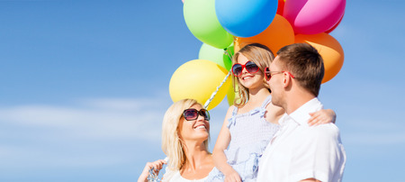children celebration: summer holidays, celebration, children and people concept - family with colorful balloons