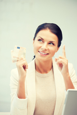 cash money: picture of happy woman with laptop computer and euro cash money Stock Photo