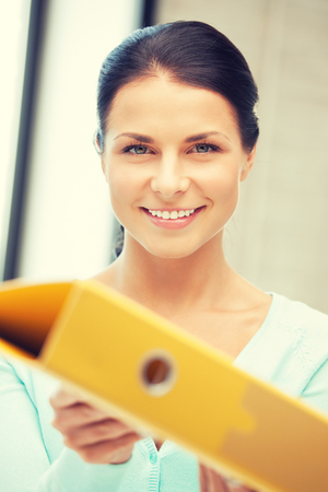 yuppie: bright picture of beautiful woman with folder Stock Photo