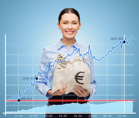 money bags: business, people, finances, investments and banking concept - young businesswoman holding money bags with euro and chart over blue background Stock Photo