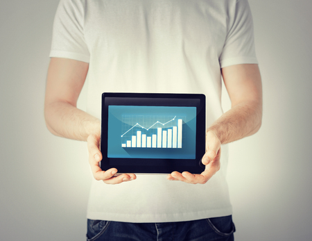 digi: business and finance  man hands holding tablet pc with graph