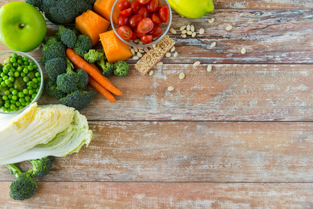 healthy eating vegetarian food advertisement and culinary concept  close up of ripe vegetables on wooden table
