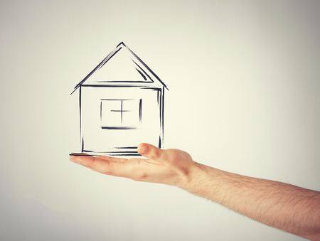 real estate technology and accomodation concept  picture of house on virtual screen in man hand photo