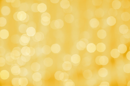 golden  gleam: holidays, party and celebration concept - blurred golden background with bokeh lights
