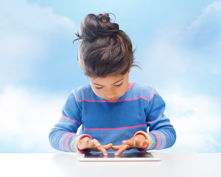 asian preteen: education, technology and children concept - little student girl with tablet pc over blue sky background