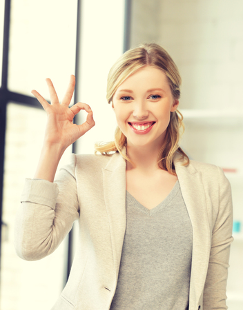 ok sign: bright picture of young woman showing ok sign