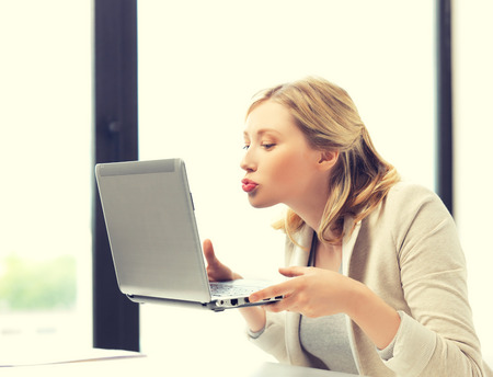 picture of woman showing funny faces to notebook photo