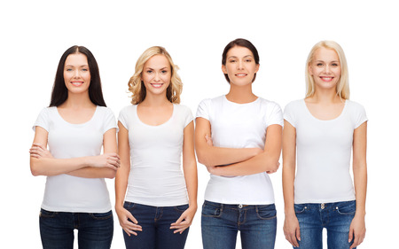 advertising woman: clothing design and people unity concept - group of happy smiling women in blank white t-shirts and jeans