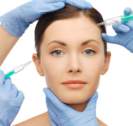dermal: health and beauty concept - woman getting dermall fillers injection