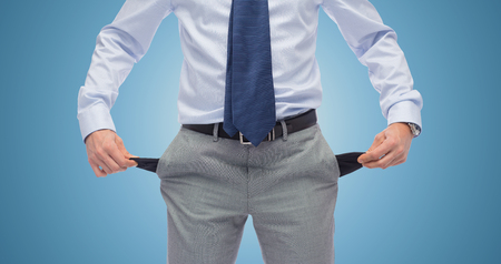 empty pockets: business, people, bankruptcy and failure concept - close up of businessman showing empty pockets over blue background