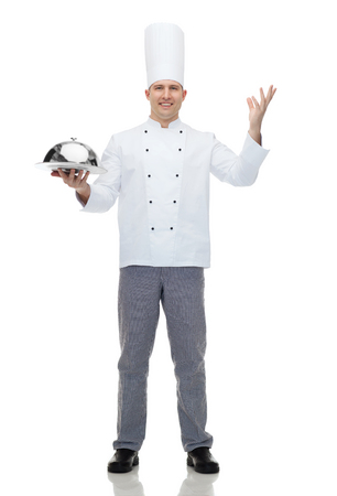 cooking implement: cooking, profession and people concept - happy male chef cook holding cloche Stock Photo