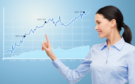 data: business, technology, statistics and people concept - businesswoman pointing finger to chart over blue background Stock Photo