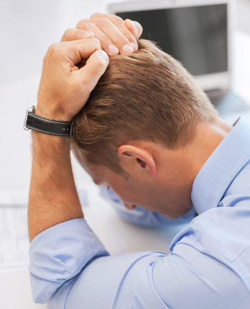 examination stress: business, office and health concept - stressed businessman at work