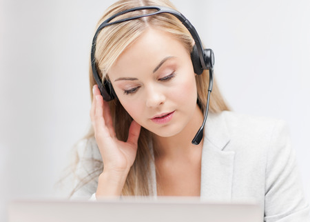 female helpline operator with headphones and laptop