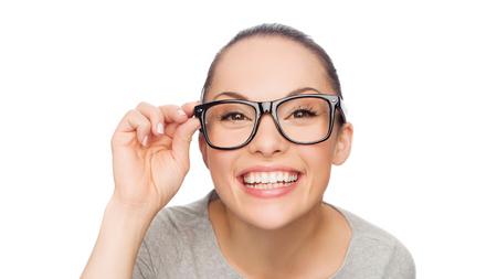 adjusting: happiness, health and vision concept - smiling asian woman adjusting eyeglasses