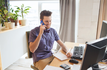 call: business, startup and people concept - happy businessman or creative male office worker with computer calling on smarphone