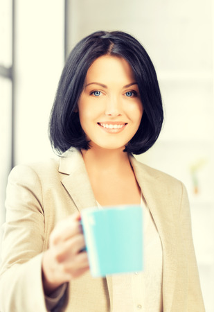 lovely businesswoman: bright picture of lovely businesswoman with mug.
