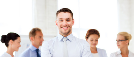 smiling businessman: picture of smiling handsome businessman in office