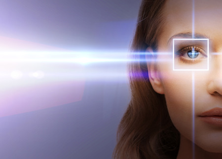 health, vision, sight - woman eye with laser correction frame Stockfoto