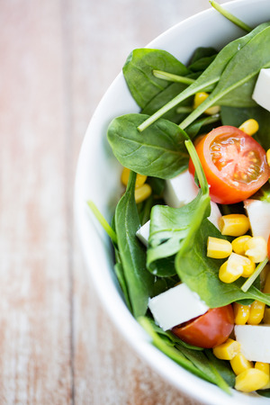 healthy eating, dieting, vegetarian kitchen and cooking concept - close up of vegetable salad bowl at home 스톡 콘텐츠