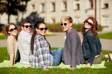 teenager: summer holidays, education, campus and teenage concept - group of students or teenagers hanging out