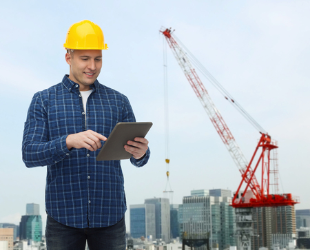 repairer: repair, construction, building, people and maintenance concept - smiling male builder or manual worker in helmet with tablet pc computer over city construction site background
