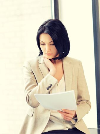 calm woman: indoor picture of calm woman with documents Stock Photo