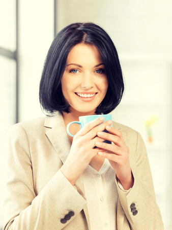 lovely businesswoman: bright picture of lovely businesswoman with mug