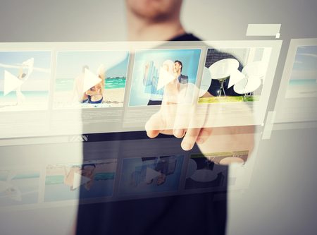 high tech world: technology, internet and networking concept - man pressing button on virtual screen Stock Photo