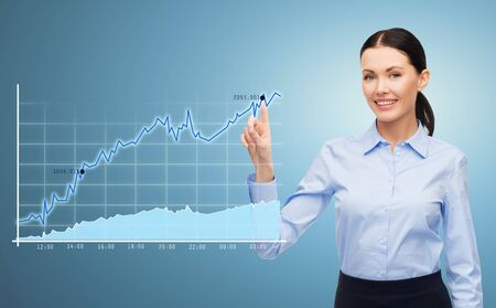 sales manager: business, technology, statistics and people concept - businesswoman pointing finger to chart over blue background Stock Photo