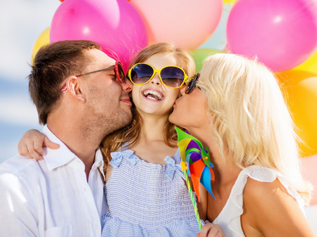 birthday balloon: summer holidays, celebration, children and people concept - family with colorful balloons