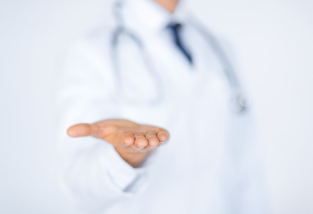 close up of male doctor holding something in his hand Фото со стока