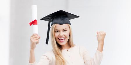 mortar hat: happy student in graduation cap with certificate