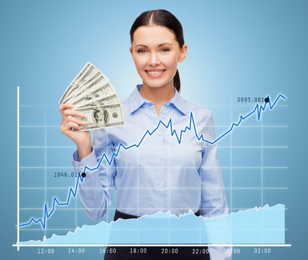 american banker: business and money concept - young businesswoman with dollar cash money and chart over blue background