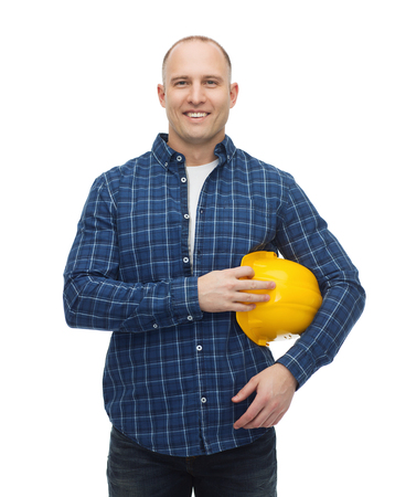 repair, building, construction and maintenance concept - smiling man in helmet with gloves Imagens - 45904908