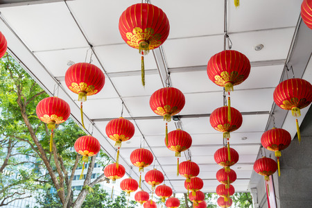 tradition: asia, tradition and holidays concept - ceiling decorated with hanging chinese lanterns Stock Photo