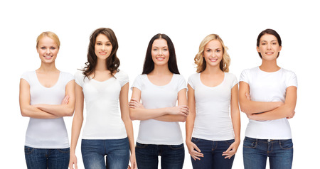 women in jeans: clothing design and people unity concept - group of happy smiling women in blank white t-shirts and jeans