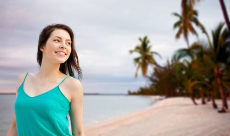 looking aside: summer holidays, people, youth and happiness concept - happy girl or young woman looking aside Stock Photo