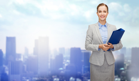 business education: business, people and education concept - smiling young businesswoman with holding over city background