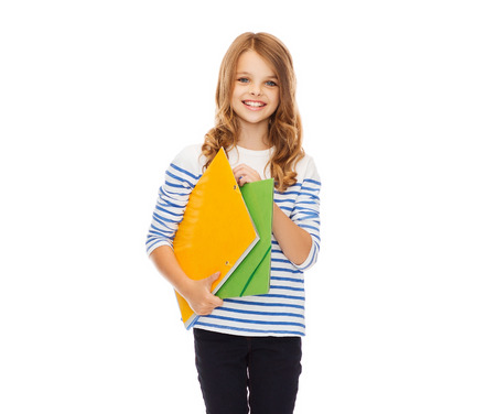 children learning: education and school concept - child holding colorful folders Stock Photo