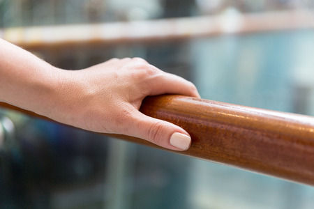 handrail: support, help and people concept - close up of woman hand holding to railing