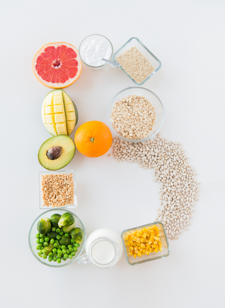 vegetarian food: healthy eating, vegetarian food, diet and culinary concept - close up of food ingredients in letter b shape