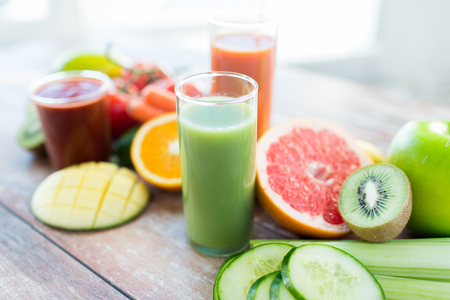 eating up: healthy eating, food and diet concept- close up of fresh juice glass and fruits on table Stock Photo
