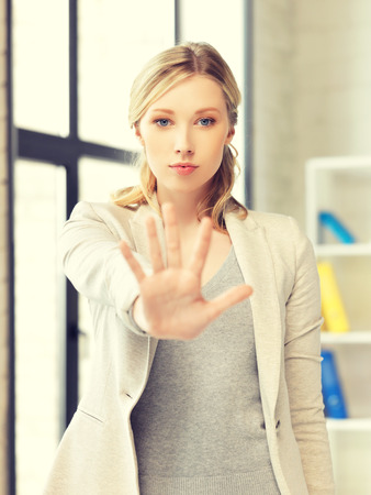 interdiction: picture of young woman making stop gesture Stock Photo