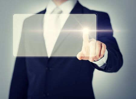 telecommute: close up of male hand touching virtual screen Stock Photo