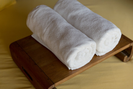 towel: luxury and hygiene concept - rolled bath towels at hotel spa