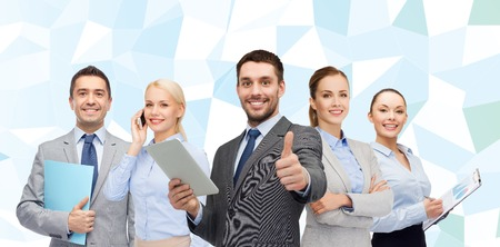 executive woman: business, people, gesture and office concept - group of smiling businessmen showing thumbs up over blue low poly background
