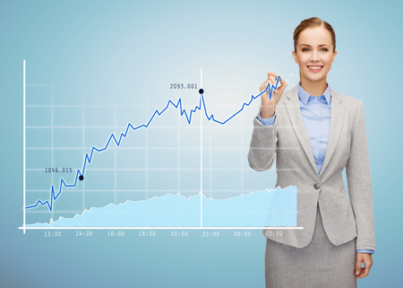 charts graphs: business, people and education concept - smiling young businesswoman drawing growing chart over blue background