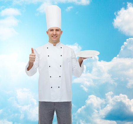 empty of people: cooking, profession, advertisement and people concept - happy male chef cook holding something on empty plate and showing thumbs up over blue sky with clouds background
